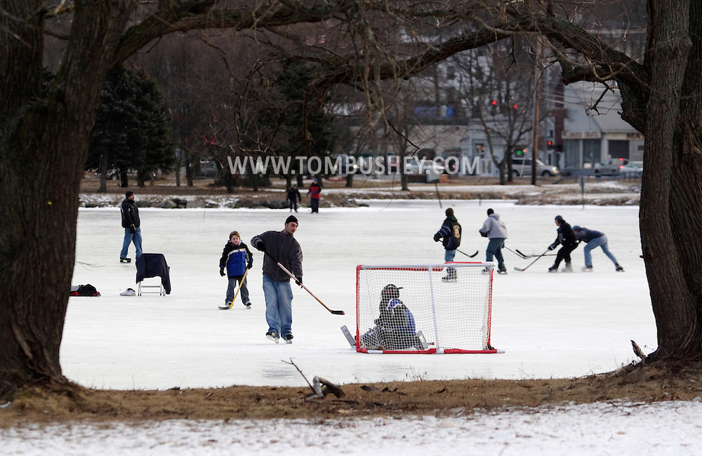 Monroe, N.Y. - People ice skate and play ice hockey on the Mill Pond in the center of town on Feb. 11, 2007.