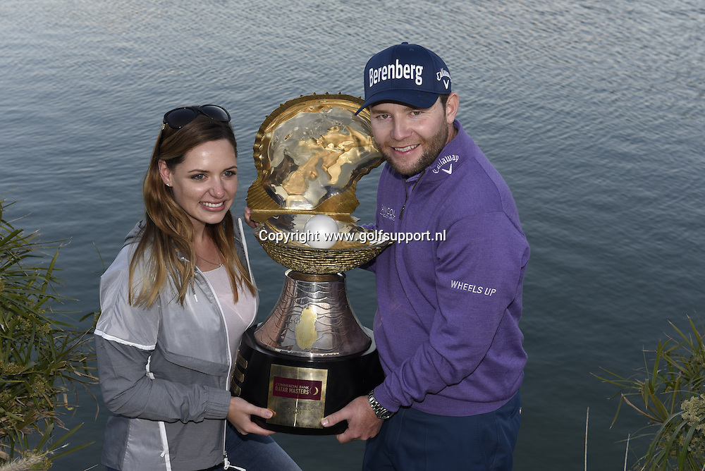 30/01/2016 European Tour 2016, Commercial Bank Qatar Masters, Doha GC, Doha, Qatar. 27-30 Jan. Branden  Grace of South Africa the winner with the trophy and his fiancee