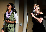 A volunteer participates with a contestant during the talent portion of the faculty pageant.