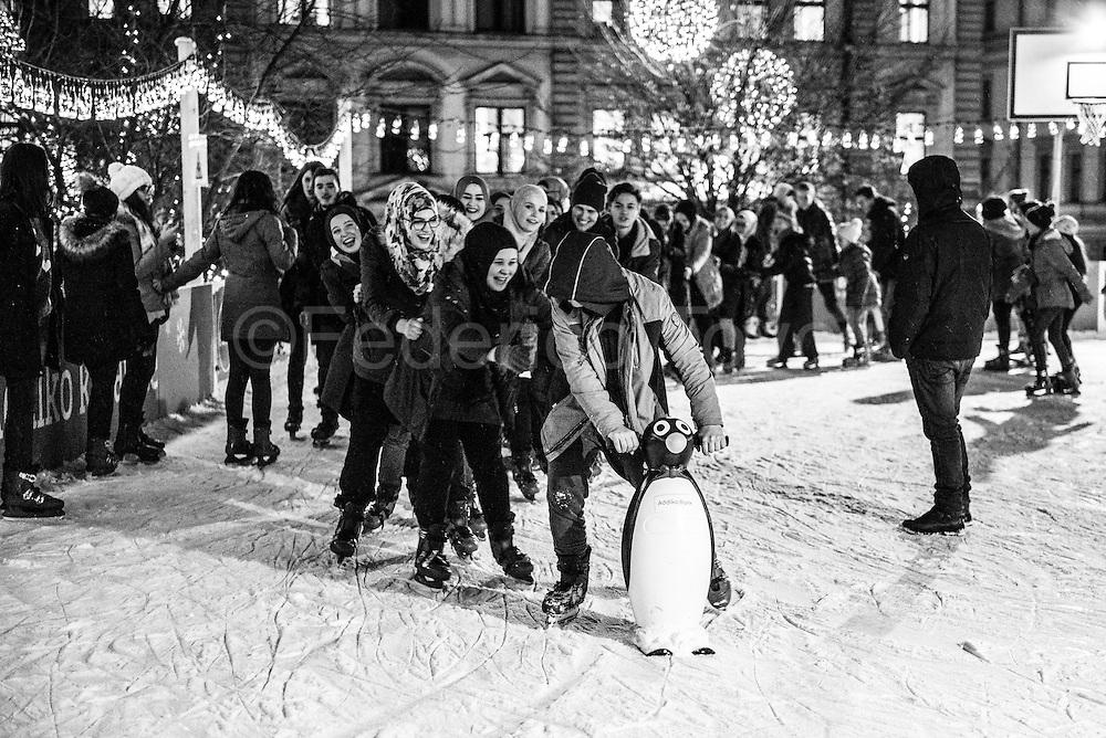Muslim girls  having fun on the ice rink in the center of Sarajevo