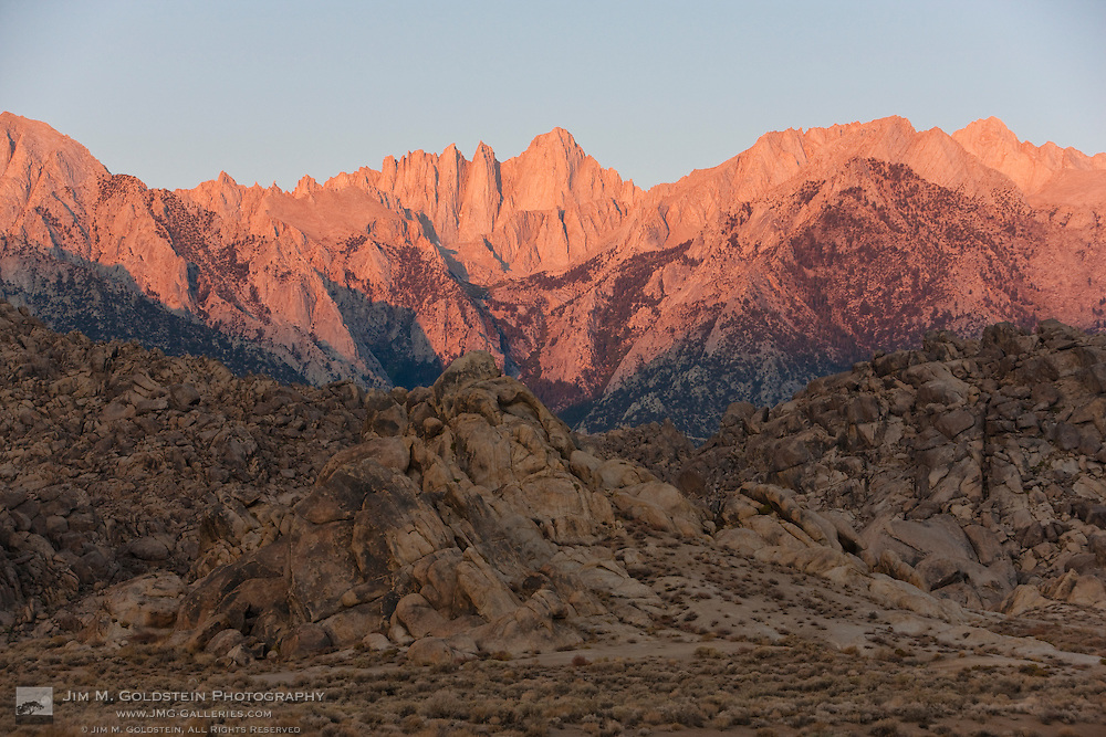 Alpen glow illuminates Mount Whitney as seen from the Alabama Hills, California