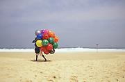 A ball vendor walks the empty beach at Ipanema Beach, Rio de Janiero, Brazil.