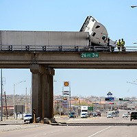 040114       Adron Gardner/Independent<br /> <br /> A tractor trailer leans on the Interstate 40 overpass railing at exit 26 in Gallup Tuesday.