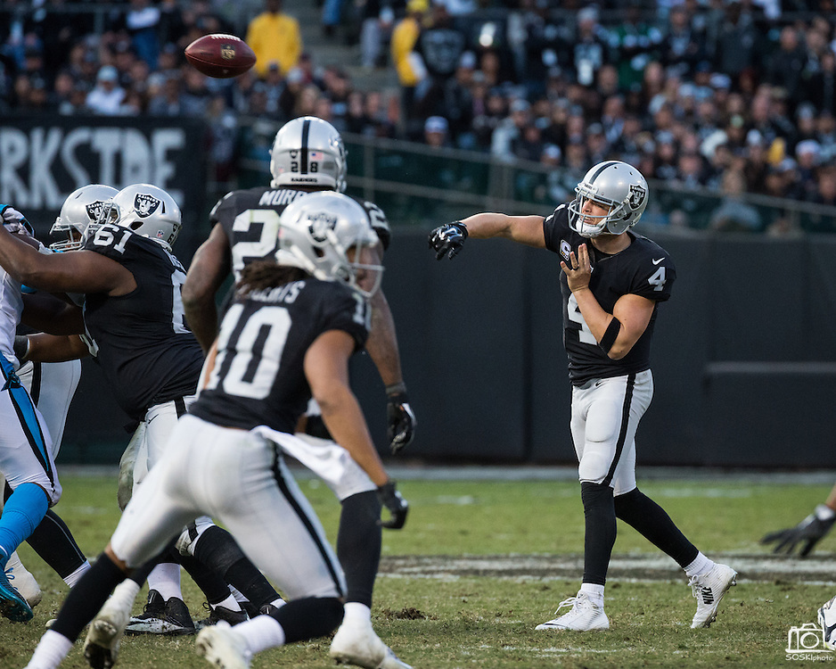 Oakland Raiders quarterback Derek Carr (4) throws a pass to a receiver against the Carolina Panthers at Oakland Coliseum in Oakland, Calif., on November 27, 2016. (Stan Olszewski/Special to S.F. Examiner)