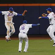 NEW YORK, NEW YORK - APRIL 27: New York Mets outfielders Juan Lagares #12, (left), Alejandro De Aza #16, (center) and Michael Conforto #30, (right), celebrate their sides 5-2 victory during the New York Mets Vs Cincinnati Reds MLB regular season game at Citi Field on April 27, 2016 in New York City. (Photo by Tim Clayton/Corbis via Getty Images)