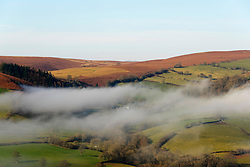 © Licensed to London News Pictures. 06/02/2020. Cregina, Powys, Wales, UK. Cloud hangs in the valleys  near Cregina in Powys, Wales, UK. Photo credit: Graham M. Lawrence/LNP