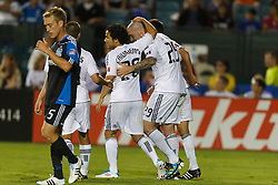 July 20, 2011; Santa Clara, CA, USA;  Vancouver Whitecaps forward Eric Hassli (29) is congratulated by midfielder/forward Davide Chiumiento (20) after scoring a goal against the San Jose Earthquakes during the second half at Buck Shaw Stadium. San Jose tied Vancouver 2-2.