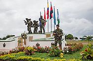 La Macarena, Meta, Colombia - 14.09.2016        <br /> <br /> A Colombian soldier protecting the few days old memorial for fallen soldiers in La Macarena. The village was once FARC controlled, some areas arround a still part of the FARC controlled region. <br /> <br /> Ein kolumbianischer Soldaten bewacht das vor wenigen Tagen eingeweihte Mahnmal fuer gefallene Soldaten im Dorfs La Macarena. Das Dorf befand sich frueher in dem von der FARC kontrollierten Gebiet, die FARC kontrolliert auch weiterhin Teile der umliegenden Landschaft.<br /> <br /> Photo: Bjoern Kietzmann