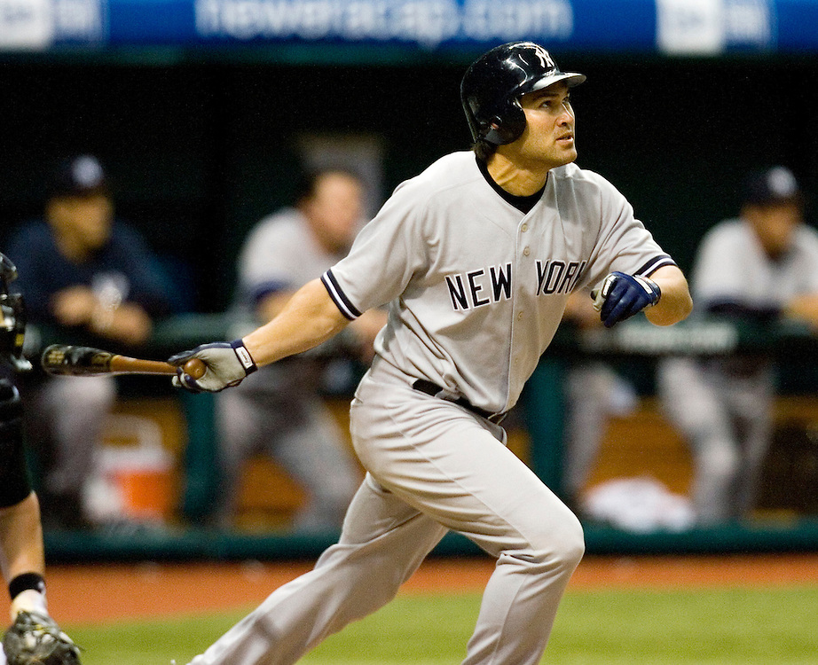 New York Yankees designated hitter Johnny Damon hits a grand slam off of Tampa Bay Devil Rays pitcher Dan Micceli during the eighth inning of their American League baseball game on Thursday, May 4, 2006 in St. Petersburg, Fla.(AP Photo/Scott Audette)