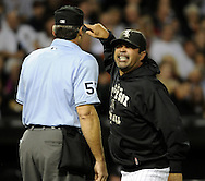CHICAGO - SEPTEMBER 10:  Manager Ozzie Guillen #13 of the Chicago White Sox argues with home plate umpire Angel Hernandez #55 after Hernandez ejected Guillen during the game against the Kansas City Royals on September 10, 2010 at U.S. Cellular Field in Chicago, Illinois.  Guillen was arguing the second balk of the game called on White Sox starting pitcher Mark Buehrle.  The White Sox defeated the Royals 4-3.  (Photo by Ron Vesely)