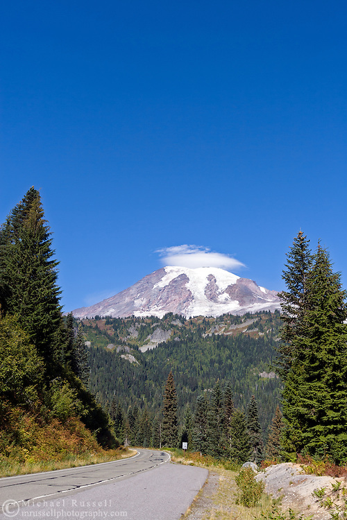 Lenticular cloud forming over Mt. Rainier from the road to Stevens Canyon in Mount Rainier National Park, Washington State, USA