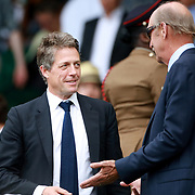 LONDON, ENGLAND - JULY 16:  Hugh Grant at the Mixed Doubles Final on Center Court during the Wimbledon Lawn Tennis Championships at the All England Lawn Tennis and Croquet Club at Wimbledon on July 16, 2017 in London, England. (Photo by Tim Clayton/Corbis via Getty Images)