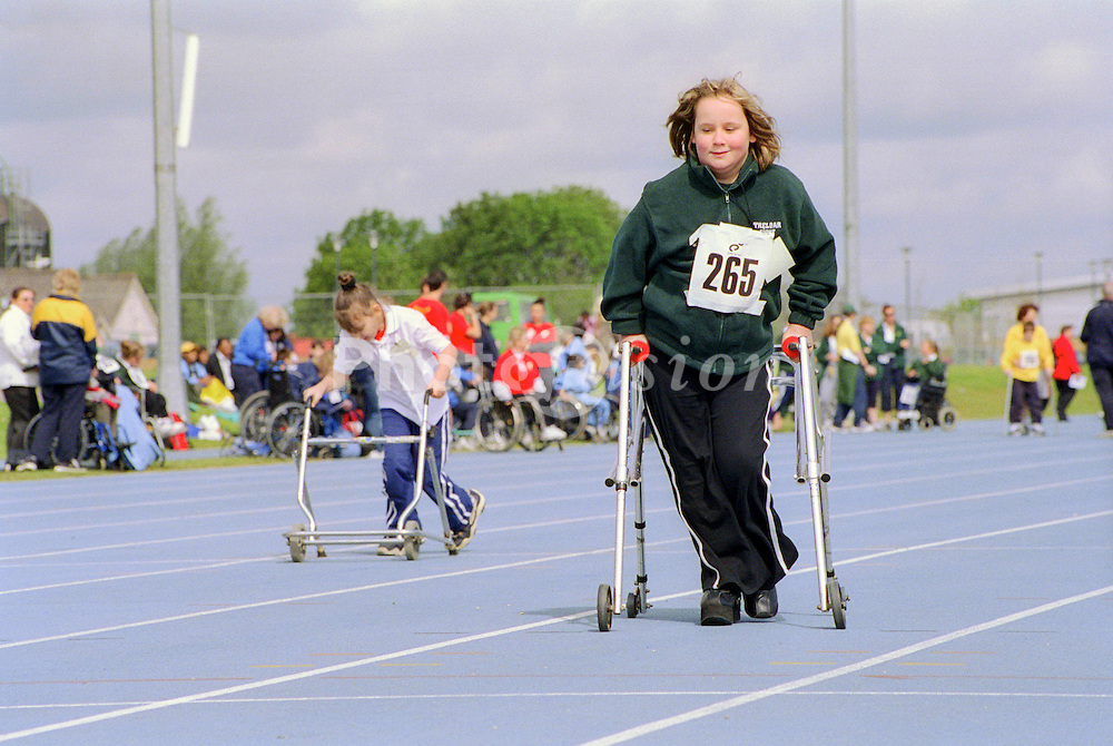 Young girls with disabilities taking part in Mini games sports event held at Stoke Mandeville Stadium,
