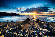 The sun sets over Turnagain Arm in a beautiful fall evening near Anchorage Alaska
