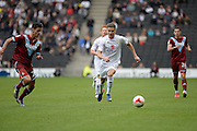 Milton Keynes Dons midfielder Ryan Colclough (49) looks to release the ball  during the EFL Sky Bet League 1 match between Milton Keynes Dons and Port Vale at stadium:mk, Milton Keynes, England on 9 October 2016. Photo by Dennis Goodwin.