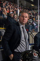 KELOWNA, BC - NOVEMBER 8: Medicine Hat Tigers' assistant coach Ryan Smith stands on the bench against the Kelowna Rockets  at Prospera Place on November 8, 2019 in Kelowna, Canada. (Photo by Marissa Baecker/Shoot the Breeze)