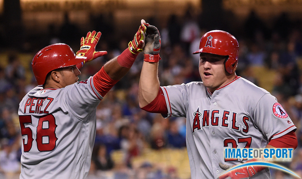 May 16, 2016; Los Angeles, CA, USA; Los Angeles Angels center fielder Mike Trout (27) is congratulated by catcher Carlos Perez (58) after scoring in the seventh inning against the Los Angeles Dodgers during an interleague MLB game at Dodger Stadium.