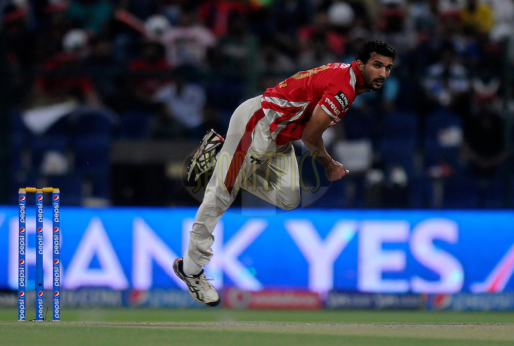 Rishi Dhawan of the Kings X1 Punjab bowls during match 15 of the Pepsi Indian Premier League 2014 Season between The Kings XI Punjab and the Kolkata Knight Riders held at the Sheikh Zayed Stadium, Abu Dhabi, United Arab Emirates on the 26th April 2014<br /> <br /> Photo by Pal Pillai / IPL / SPORTZPICS