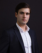 Formal business portrait of young male executive by Houston Professional headshot photographer Gerard Harrison Image Theory Photoworks