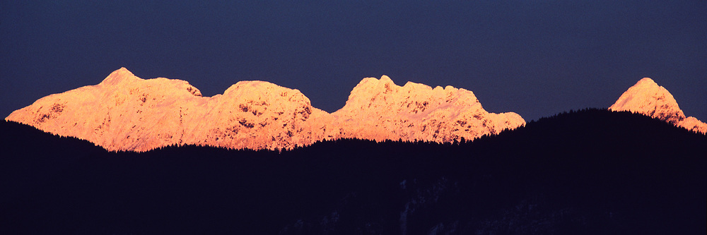 Golden Ears mountain peaks with snow at sunset