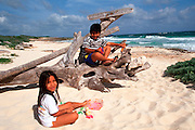 MEXICO, COZUMEL, TOURISM children on beach at Paradise Café