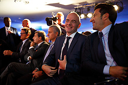 © Licensed to London News Pictures. 01/02/2016. London, UK. FIFA Presidential Candidate, Gianni Infantino (C) unveils his 90 day plan that he will implement if he is elected FIFA President with Luís Figo (R), at Wembley Stadium in London on Monday 1 February 2016. Photo credit: Tolga Akmen/LNP