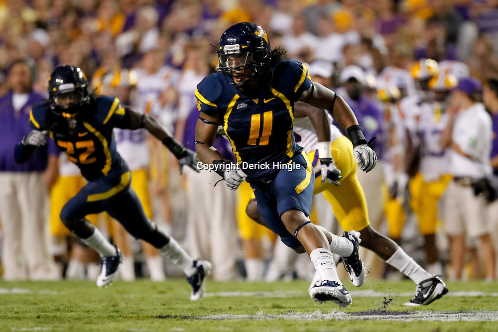 Sep 25, 2010; Baton Rouge, LA, USA; West Virginia Mountaineers linebacker Bruce Irvin (11) pursues a play during the second half against the LSU Tigers at Tiger Stadium. LSU defeated West Virginia 20-14.  Mandatory Credit: Derick E. Hingle