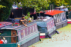 According to the Met Office, August 31st marks the last day of summer and there certainly is a bit of a nip in the air around Little Venice in London as a man relaxes on the roof of his narrowboat on the Grand Union Canal. London, August 31 2018.