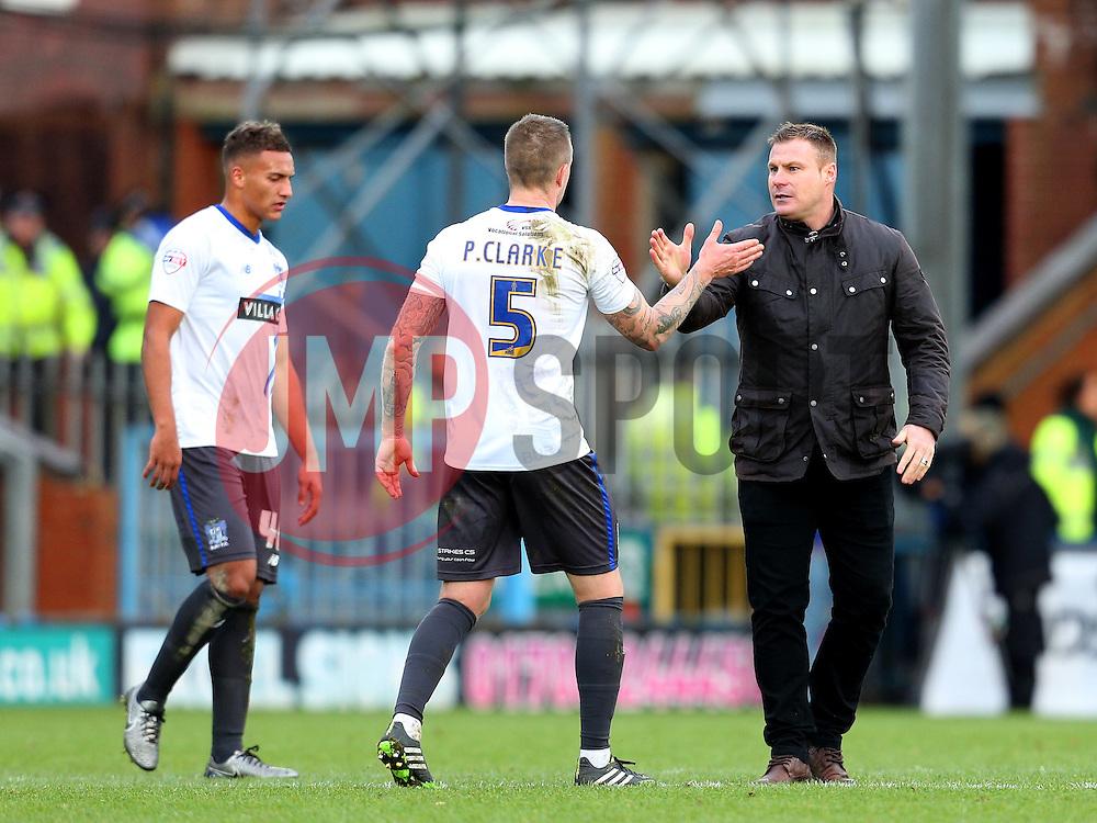 Bury Manager David Flitcroft celebrates victory at full time with Peter Clarke  - Mandatory byline: Matt McNulty/JMP - 06/12/2015 - Football - Spotland Stadium - Rochdale, England - Rochdale v Bury - FA Cup