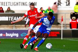 Michael Smith of Rotherham United puts pressure on Rollin Menayese of Bristol Rovers - Mandatory by-line: Ryan Crockett/JMP - 18/01/2020 - FOOTBALL - Aesseal New York Stadium - Rotherham, England - Rotherham United v Bristol Rovers - Sky Bet League One