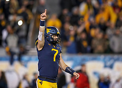 Oct 25, 2018; Morgantown, WV, USA; West Virginia Mountaineers quarterback Will Grier (7) celebrates a big play during the second quarter against the Baylor Bears at Mountaineer Field at Milan Puskar Stadium. Mandatory Credit: Ben Queen-USA TODAY Sports