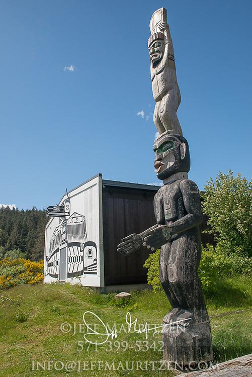 Totem pole outside of U'mista Cultural Centre in Alert Bay, British Columbia.
