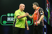 Mensur Suljovic congratulates Michael van Gerwen on his win during the PDC Unibet Masters 2017 at Arena MK, Milton Keynes, United Kingdom on 29 January 2017. Photo by Shane Healey.
