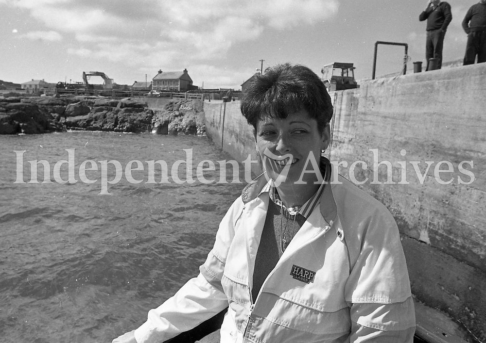 Picture of a woman by the sea, name, date and location unknown. <br /> (Part of the Independent Ireland Newspapers/NLI Collection)