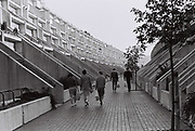 Friends walking through estate in Maida Vale, London, UK, 1983