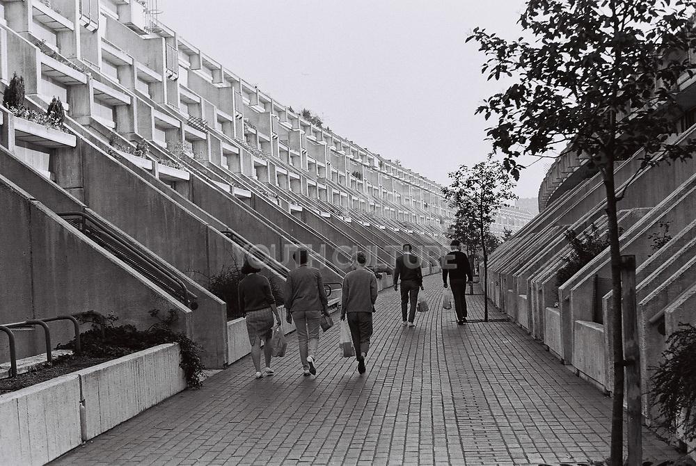Friends walking through estate in Maida Vale, London, UK, 1983