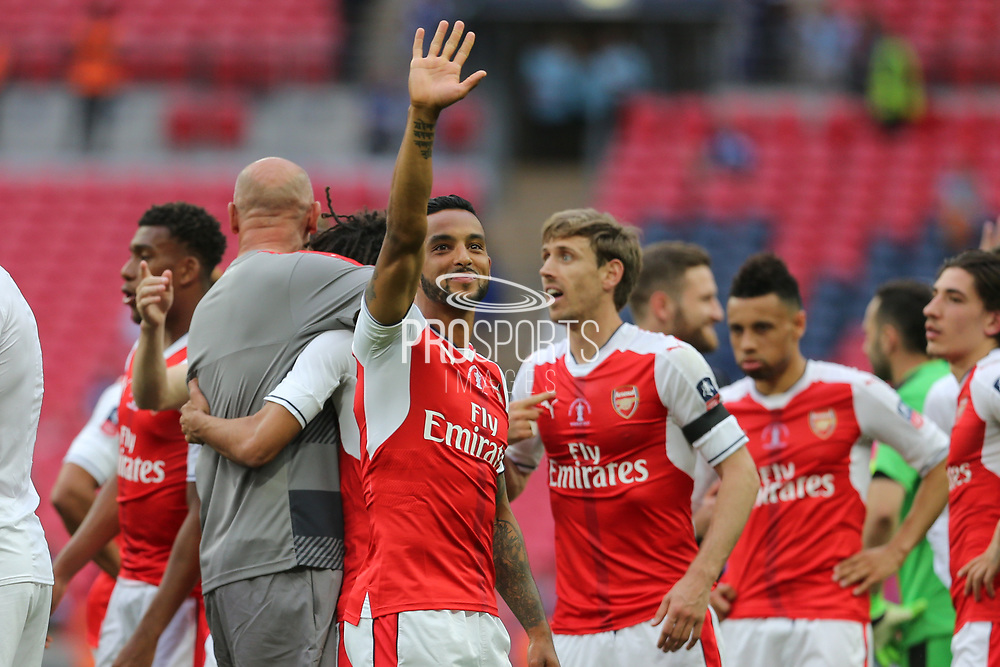Arsenal's Theo Walcott(14) waves to someone in the crowd during the The FA Cup final match between Arsenal and Chelsea at Wembley Stadium, London, England on 27 May 2017. Photo by Shane Healey.
