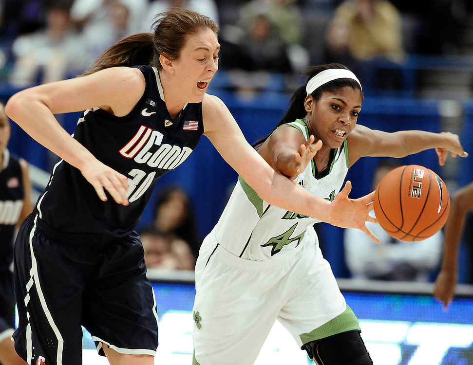 Connecticut's Breanna Stewart, left, steals the ball from Notre Dame's Ariel Braker, right, in the second half of an NCAA college basketball game in the final of the Big East Conference women's tournament in Hartford, Conn., Tuesday, March 12, 2013. (AP Photo/Jessica Hill)