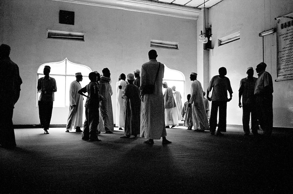 Nubian men gather at the Makina mosque. The Makina mosque is the center point for religious, social and community events for the Nubian community in Kibera.