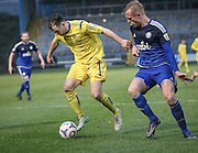 Will Hatfield (Guiseley) keeps Jordan Burrow (Halifax) off the ball during the Conference Premier League match between FC Halifax Town and Guiseley at the Shay, Halifax, United Kingdom on 5 December 2015. Photo by Mark P Doherty.
