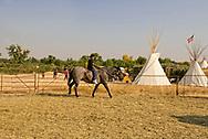 Henry Real Bird, grandkids, riding, Crow Fair, Crow Indian Reservation, Montana