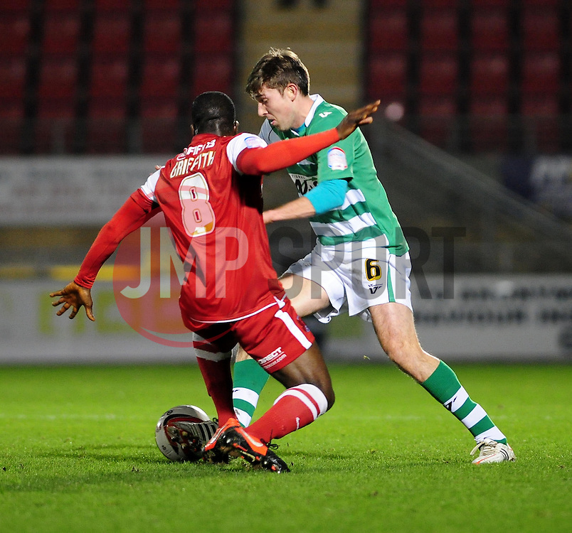 Leyton Orient's Anthony Griffith challenges Yeovil Town Dominic Blizzard - Photo mandatory by-line: Dougie Allward/JMP - Tel: Mobile: 07966 386802 09/01/2013 - SPORT - FOOTBALL - Matchroom Stadium - London -  Leyton Orient v Yeovil Town - Johnstone's Paint Trophy Southern area semi-final.