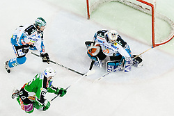 Ales Music (HDD Tilia Olimpija, #16) vs Alex Westlund (EHC Liwest Linz, #32) during ice-hockey match between HDD Tilia Olimpija and EHC Liwest Black Wings Linz at fourth match in Semifinal  of EBEL league, on March 13, 2012 at Hala Tivoli, Ljubljana, Slovenia. (Photo By Matic Klansek Velej / Sportida)