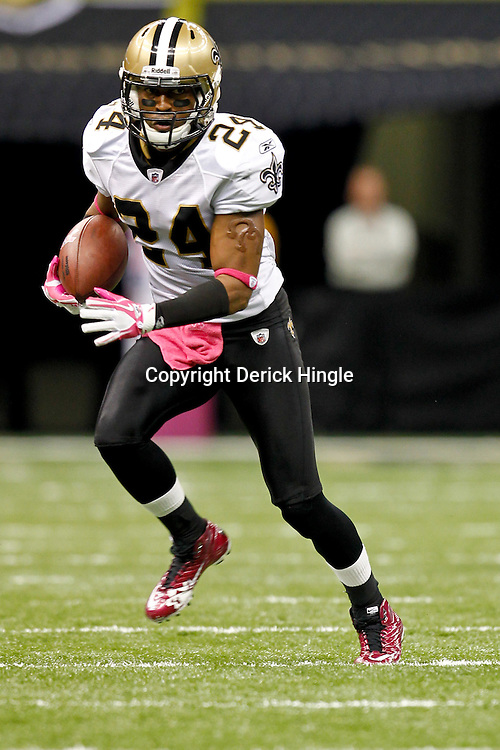 October 23, 2011; New Orleans, LA, USA; New Orleans Saints cornerback Leigh Torrence (24) returns an interception for a touchdown against the Indianapolis Colts during the fourth quarter of a game at the Mercedes-Benz Superdome. The Saints defeated the Colts 62-7. Mandatory Credit: Derick E. Hingle-US PRESSWIRE / © Derick E. Hingle 2011