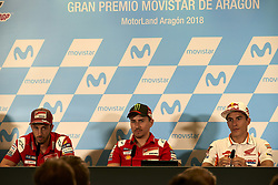 September 22, 2018 - Alcaniz, Teruel, Spain - Andrea Dovizioso (4) of Italy and Ducati Team, Jorge Lorenzo (99) of Spain and Ducati Team  and Marc Marquez (93) of Spain and Repsol Honda Team during press conference after qualifying for the Gran Premio Movistar de Aragon of world championship of MotoGP at Motorland Aragon Circuit on September 22, 2018 in Alcaniz, Spain. (Credit Image: © Jose Breton/NurPhoto/ZUMA Press)