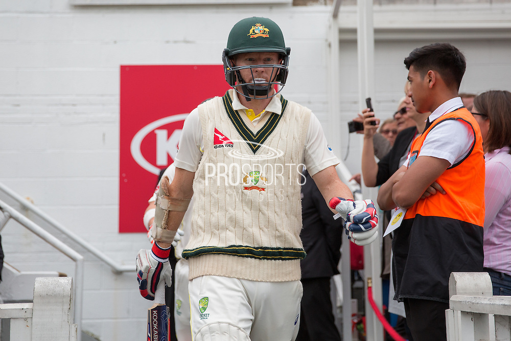 Chris Rogers of Australia leads the team out before  the 1st day of the 5th Investec Ashes Test match between England and Australia at The Oval, London, United Kingdom on 20 August 2015. Photo by Phil Duncan.