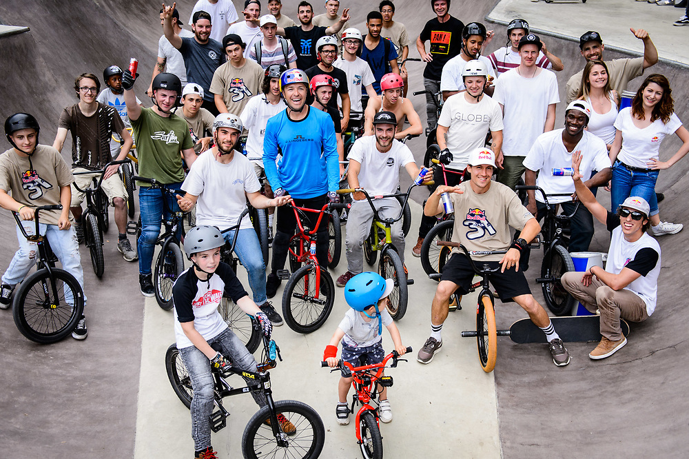 Senad Grosic, Viki Gomez, Courage Adams and Danny Leon pose for a group portrait with local riders during Red Bull 3en1 at Skatepark Péitruss, Luxembourg, Luxembourg, June 3, 2017.
