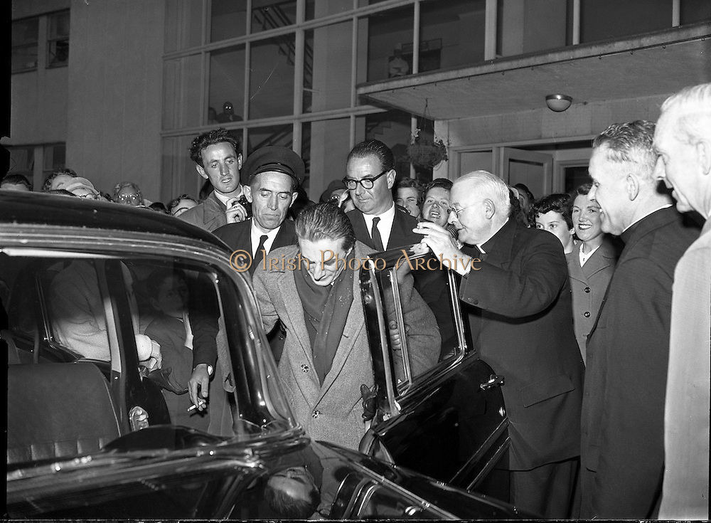 06/06/1957<br /> 06 June 1957<br /> <br /> Daily Express - Sir John Barbirolli at Dublin Airport<br /> <br /> <br /> Sir John Barbirolli (02/12/1899 – 29/07/1970) was an English conductor and cellist. Born in London, of Italian and French parentage, he grew up in a family of professional musicians. His father and grandfather were violinists. Barbirolli was the first of the family to become a conductor.<br />Barbirolli is remembered above all as conductor of the Hallé Orchestra in Manchester, which he helped save from dissolution in 1943 and conducted for the rest of his life. Earlier in his career he was Arturo Toscanini's successor as music director of the New York Philharmonic, serving there from 1936 to 1943. He was also chief conductor of the Houston Symphony from 1961 to 1967, and was a guest conductor of many other orchestras.