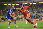 Daniel Sturridge (Liverpool) tries to go around the Chelsea defender during the Barclays Premier League match between Liverpool and Chelsea at Anfield, Liverpool, England on 11 May 2016. Photo by Mark P Doherty.