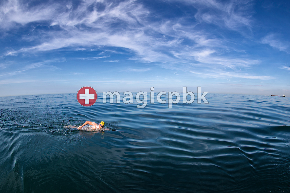 Swimmer Gino Deflorian of Switzerland swims while crossing the English Channel in 11 Hours 6 Minutes from Samphire Hoe (Great Britain) to Cap Gris Nez (France), near the coast of Samphire Hoe/Dover, Great Britain, Tuesday, Aug. 20, 2013. Gino Deflorian is the first Swiss male swimmer who successfully swims the English Channel and the third Swiss. (Photo by Patrick B. Kraemer / MAGICPBK)